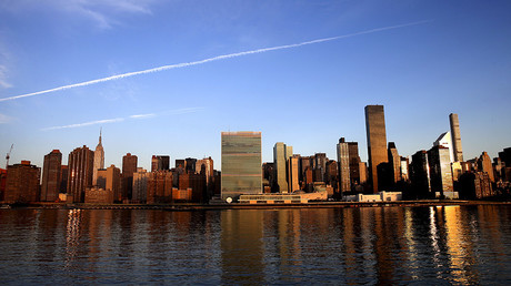 The United Nations headquarters and the East Side of Manhattan are seen at sunrise in New York City © Mike Segar