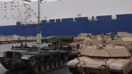 100s more US tanks & military hardware arrive in Europe to keep 'peace & freedom' at Russian borders