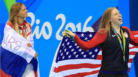 Gold medallist Lilly King (USA) and silver medallist Yulia Efimova (RUS) celebrate with their national flags during 2016 RIo Olympic Games © Dominic Ebenbichler