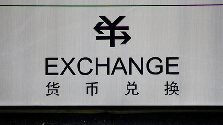 A sign for foreign currency exchange is seen in Beijing © Thomas Peter