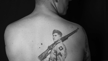 Master Sergeant Vernon Davenport shows off his tattoo of his late grandfather, J.D. Davenport, a World War II and Korean War veteran © US Air Force photo/Staff Sgt. Derek VanHorn