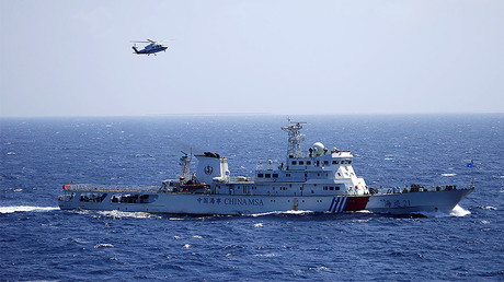 Chinese ship and helicopter are seen during a search and rescue exercise near Qilian Yu subgroup in the Paracel Islands, which is known in China as Xisha Islands, South China Sea, July 14, 2016. © Stringer