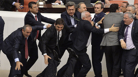 Main opposition Republican People's Party (CHP) deputy Orhan Duzgun falls down as lawmakers from his party and the ruling AK Party (R) scuffle during a debate on a legislation to boost police powers at the Turkish Parliament in Ankara late February 19, 2015. © Stringer