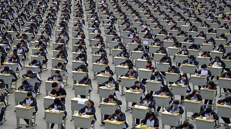Students take an examination on an open-air playground at a high school in Yichuan, Shaanxi province. © Stringer