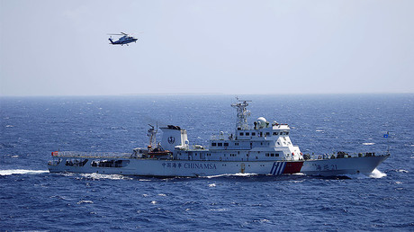 Chinese ship and helicopter in the Paracel Islands, which is known in China as Xisha Islands, South China Sea. © Stringer
