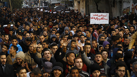 Palestinians chant slogans during a protest against the ongoing electricity crisis in Jabalia refugee camp in the northern Gaza Strip on January 12, 2017. © Mohammed  Abed