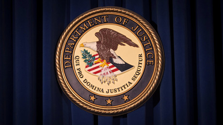 The Department of Justice (DOJ) logo is pictured on a wall in New York, United States. © Carlo Allegri