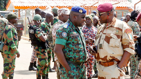 Lieutenant-Colonel Issiaka Ouattara, named Wattao speaks with Lieutenant-Colonel Herve Toure Armand Pelikan, also known as Vetcho, at the airport in Bouake, Ivory Coast January 13, 2017. © Thierry Gouegnon