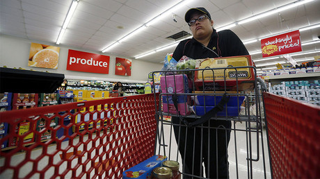 Delores Leonard shops for groceries after working a shift at a McDonald's Restaurant in Chicago, Illinois. Leonard, a single mother raising two daughters, has been working at McDonald's for seven years and has never made more than minimum wage, but gets some assistance with food stamps.  © Jim Young