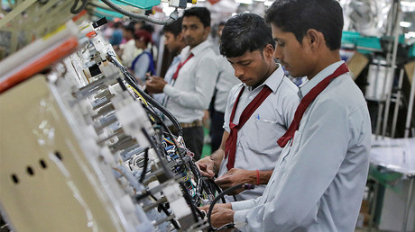 Employees of Motherson Sumi Systems Limited, work on a car wiring assembly line inside a factory in Noida on the outskirts of New Delhi © Anindito Mukherjee