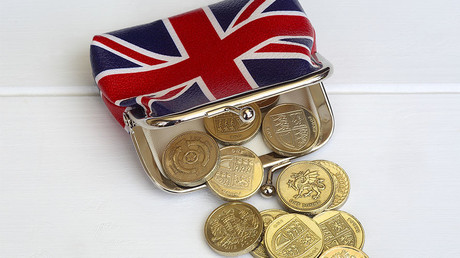 One pound coins spilling out of clip purse with Union Jack design © Getty Images