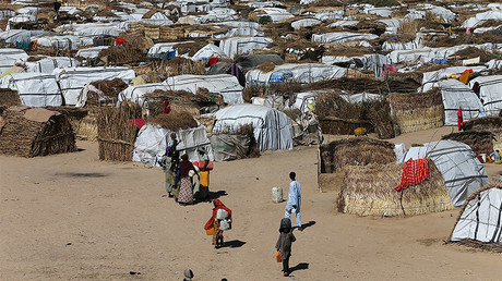 FILE PHOTO: Some people seen moving within their thatched houses at the Muna Internally displace peoples camp in Maiduguri, Nigeria. © Afolabi Sotunde