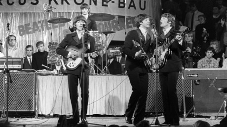 The Beatles (l-r) George Harrison, Paul McCartney, John Lennon and in the background Ring Starr at the drums, perform in Circus Krone in Munich on the 24th of June in 1966 in front of German audience. © Rauchwetter