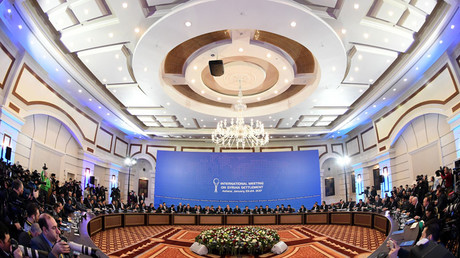 Representatives of the Syria regime and rebel groups along with other attendees take part in the first session of Syria peace talks at Astana's Rixos President Hotel on January 23, 2017. © Kirill Kudryavtsev