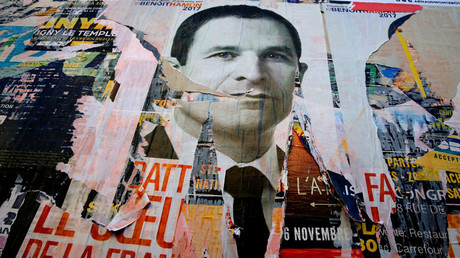 A campaign poster for Benoit Hamon, candidate in the French Socialist party presidential primaries, is seen on a wall in Paris, France, January 20, 2017. © RJacky Naegelen