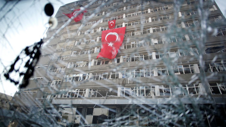 The Ankara police headquarters is seen through a car's broken window caused by fighting during a coup attempt in Ankara, Turkey, July 19, 2016. © Baz Ratner