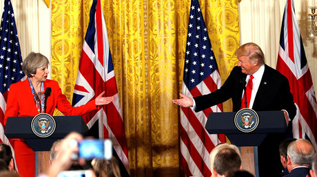 British Prime Minister Theresa May and U.S. President Donald Trump gesture towards each other during their joint news conference at the White House in Washington, U.S., January 27, 2017. © Kevin Lamarque
