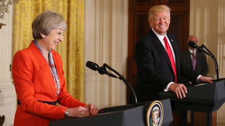 U.S. President Donald Trump and British Prime Minister Theresa May smile as they hold a joint news conference at the White House in Washington, U.S., January 27, 2017. © Carlos Barria