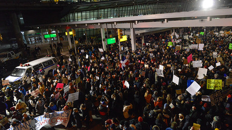 Protestors rally during a demonstration against the new immigration ban issued by President Donald Trump at John F. Kennedy International Airport on January 28, 2017 in New York City © Stephanie Keith