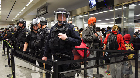 The last group of travelers allowed through the security checkpoint inside Terminal 4 at San Francisco International Airport before police block the security check point off completely in San Francisco, California, U.S., January 28, 2017. © Kate Munsch