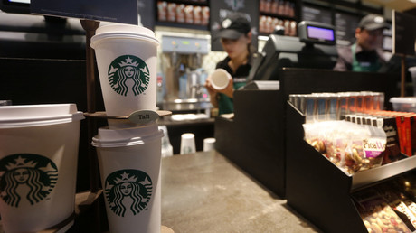 Paper cups of different sizes are seen on display at Starbucks store © John Vizcaino