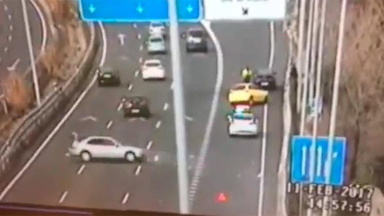 Cop cheats death in last-minute leap as car hurtles toward him (VIDEO)