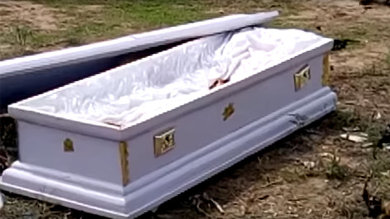 Grave situation: Corpse seized during funeral after family fail to pay fees (GRAPHIC VIDEOS)