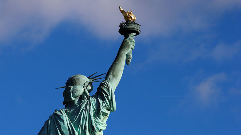 Activists hang 'Refugees Welcome' banner on Statue of Liberty