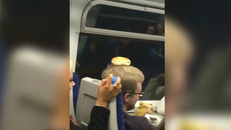 Mass drunken brawl on British train sparked by bagel (VIDEO)
