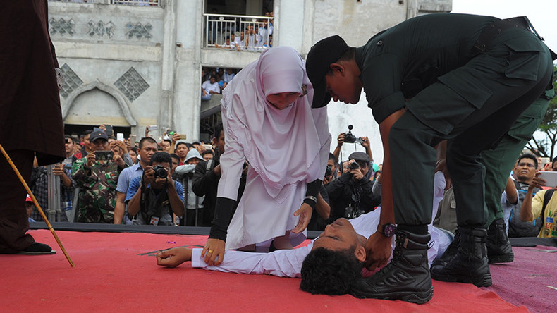 Indonesian man faints during caning, revived & caned again (PHOTOS)