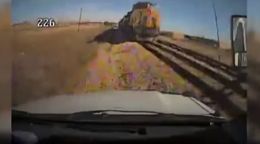 Horrifying collision of train & bus captured on camera (GRAPHIC VIDEO)
