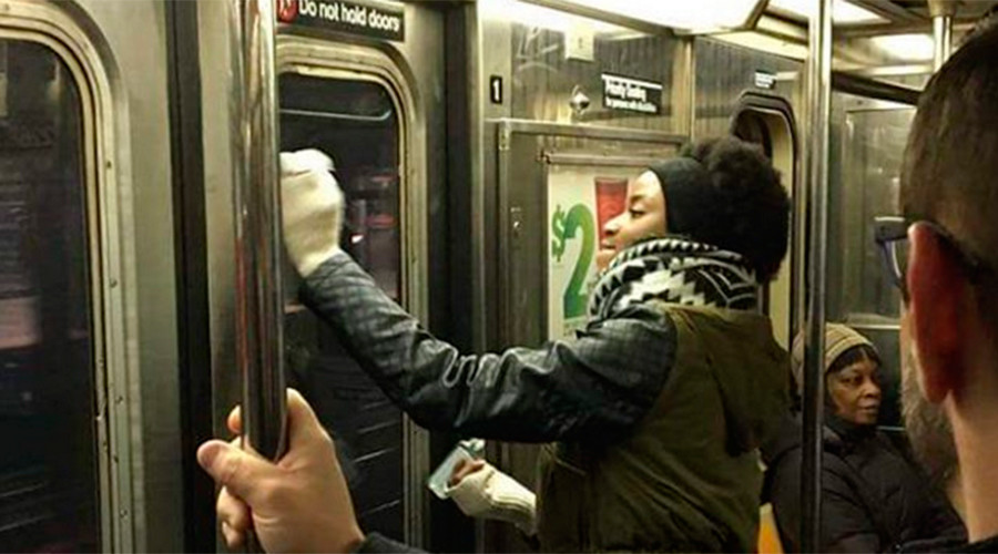 Swastika takedown: New York subway riders tackle Nazi symbols on train (PHOTOS)