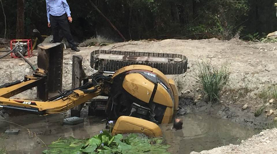 Gasping for air: Man trapped beneath digger in mud-filled dam fights for life (PHOTOS)