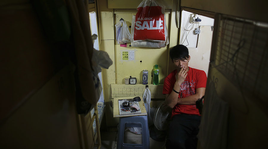 Hong Kong residents squeeze into 'coffin homes' as housing crisis worsens