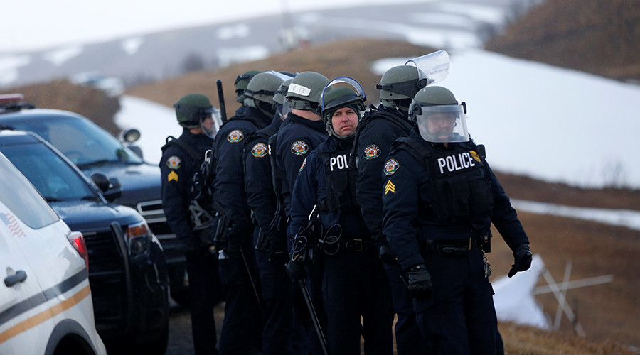 Riot police & military Humvees enter Standing Rock camp