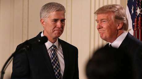 U.S. President Donald Trump looks on as Neil Gorsuch (L) approaches the podium after being nominated to be an associate justice of the U.S. Supreme Court at the White House in Washington, D.C., U.S., January 31, 2017. © Carlos Barria