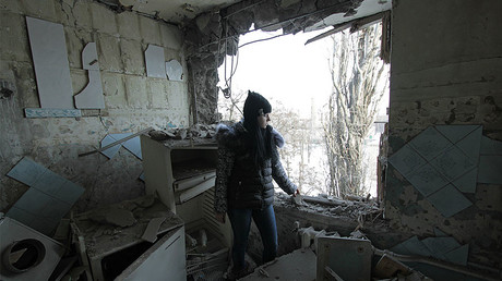Civilian resident of Donetsk in her home destroyed by shelling.