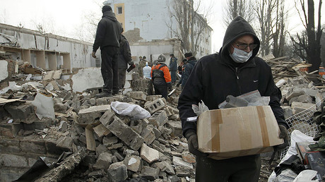 Dealing with damage: Locals in Donetsk clear debris after days of shelling (EXCLUSIVE)