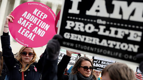 Pro-life and pro-choice activists at National March for Life rally, Washington. © Aaron P. Bernstein