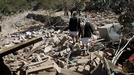 People walk on the rubble of a house destroyed by a Saudi-led air strike in Sanaa, Yemen. © Mohamed al-Sayaghi