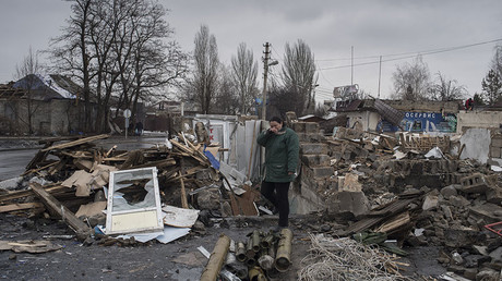 A woman on the site of a destroyed building neat the Motel bus terminal in Donetsk.© Valeriy Melnikov