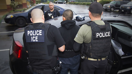 US ICE officers detaining a suspect during an enforcement operation on February 7, 2017 in Los Angeles, California. © ICE