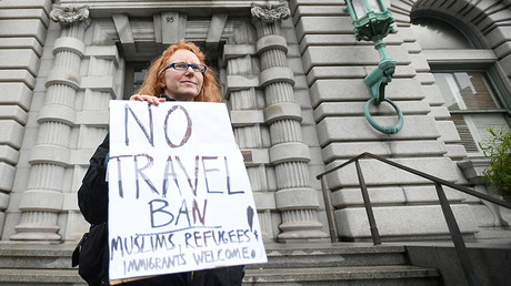 Trump drops legal challenge to travel ban, will issue new order