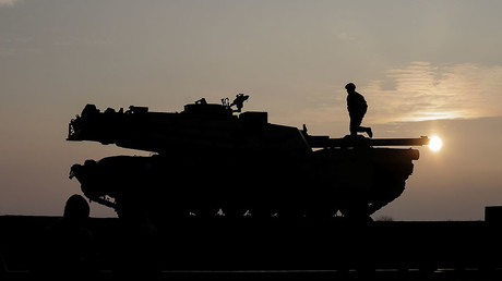 US soldiers prepare a M1 Abrams tank to offload from a train at the Mihail Kogalniceanu Air Base, Romania © Octav Ganea