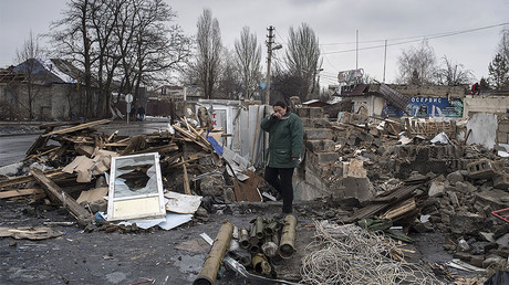 A woman on the site of a destroyed building, Donetsk. File photo. ©