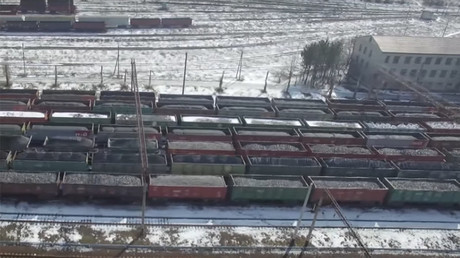 Drone captures endless lines of coal cars held up by blockade of rebel E. Ukraine (VIDEO)
