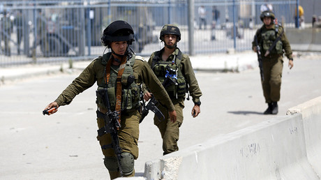 IDF soldiers on patrol © Mohamad Torokman / Reuters