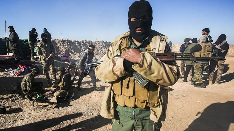 Mass grave of hundreds discovered in prison retaken from ISIS, Iraqi militias say