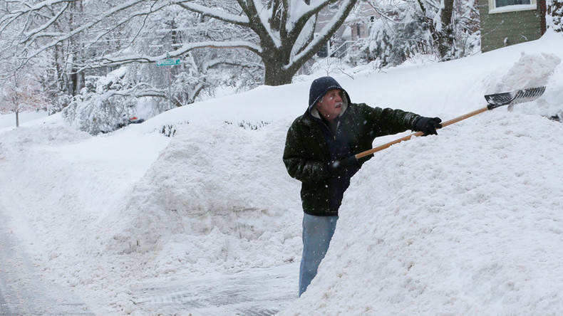 Nearly 100,000 without power as snow, sleet & strong winds lash Northeast