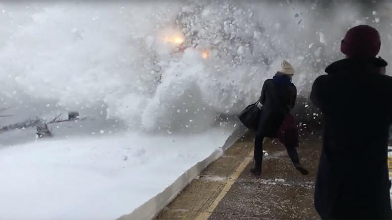 Train hurls snow bomb at commuters (VIDEOS)
